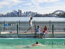 Students relaxing beside Maccallum Pool in Cremorne Point
