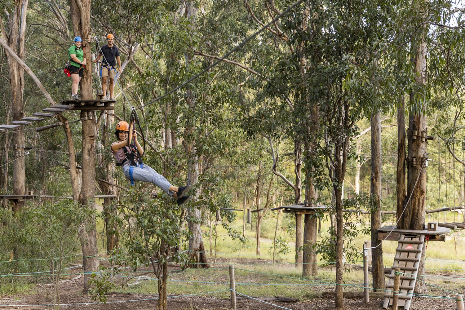 Woman enjoying the action at TreeTops Adventure Park, Abbotsbury in Sydney's south west