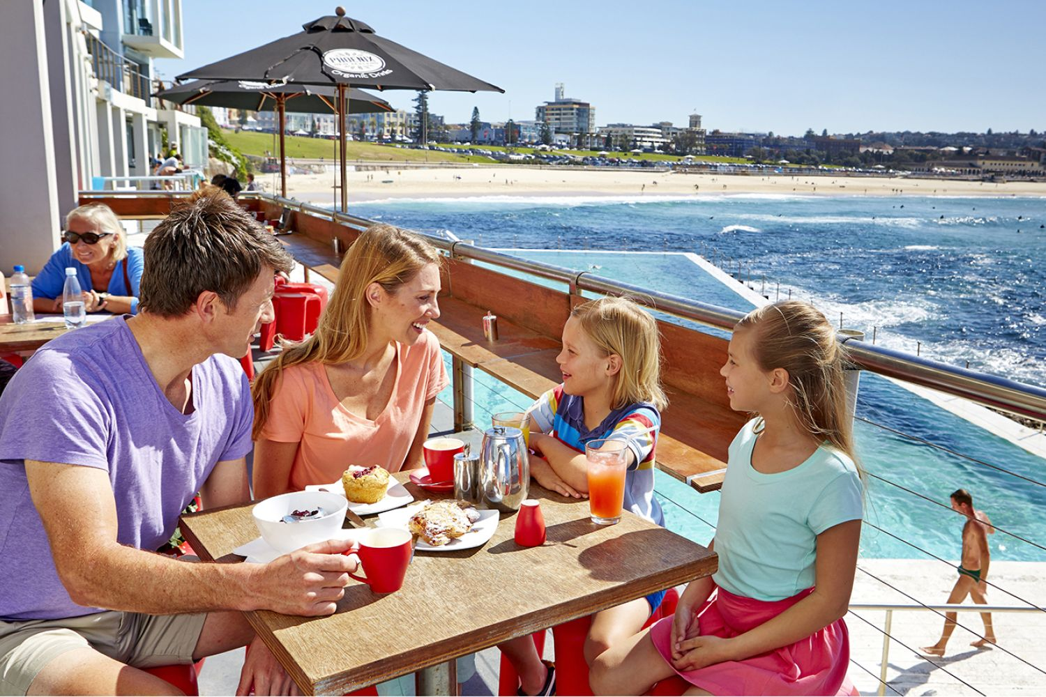 A family at the Crabbe Hole Cafe in Bondi