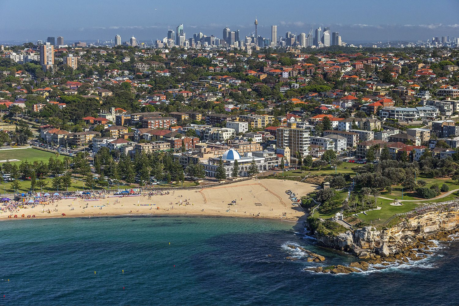 Aerial view of Coogee Beach with a view to the city in Coogee, Sydney East