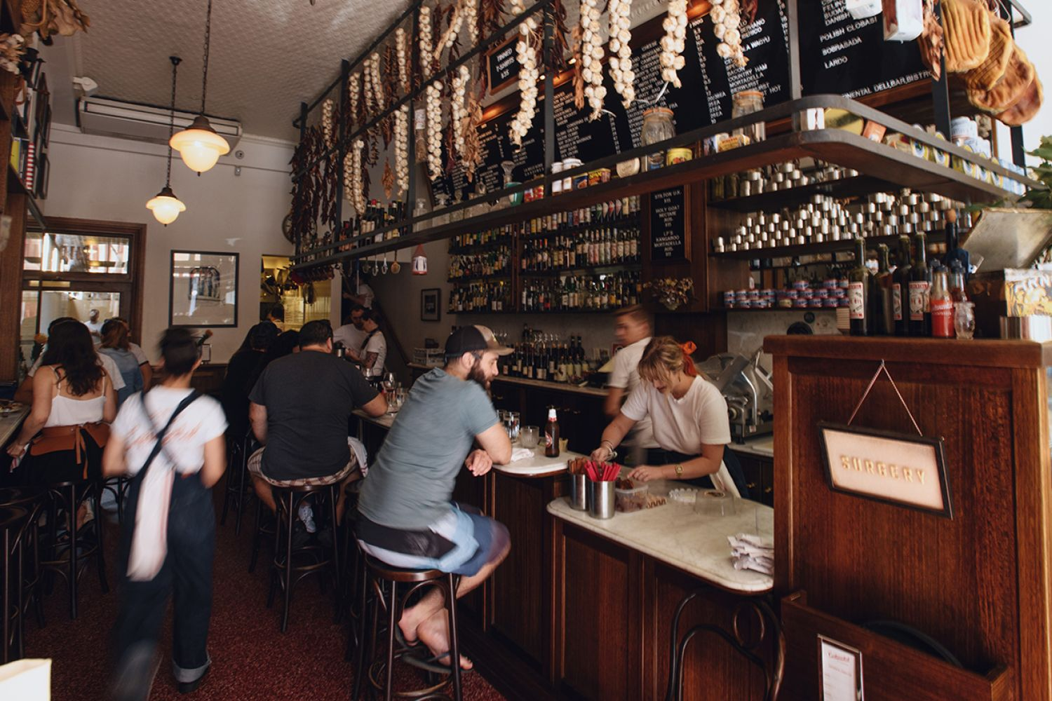People enjoying food and drink at Continental Deli Bar Bistro in Newtown, Inner Sydney
