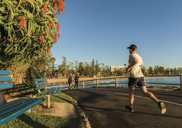 Man jogging by Manly Beach in Manly, Sydney North