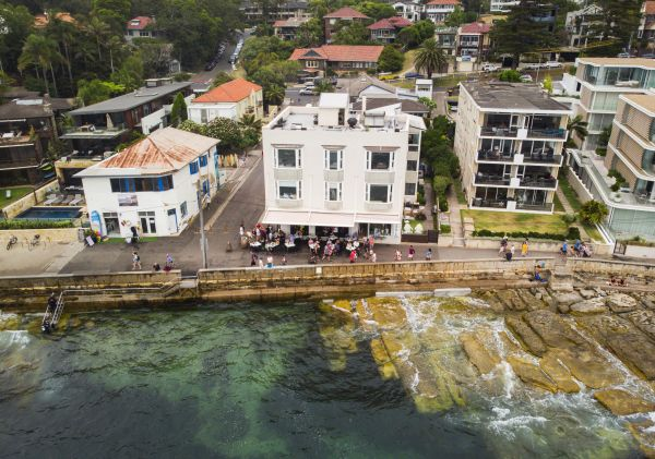 Aerial overlooking The Bower Manly restaurant and the Cabbage Tree Bay Aquatic Reserve, Manly