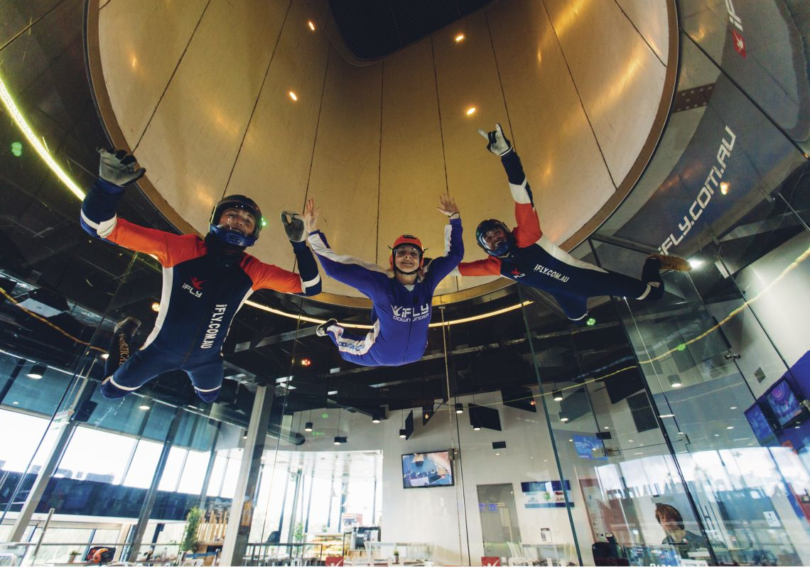 Woman enjoying an indoor skydiving experience in Penrith
