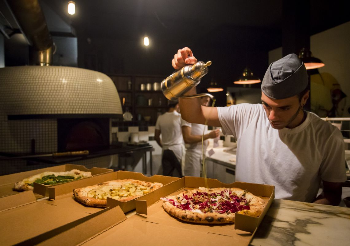 Chef preparing pizza's at Gigi Pizzeria in Newtown