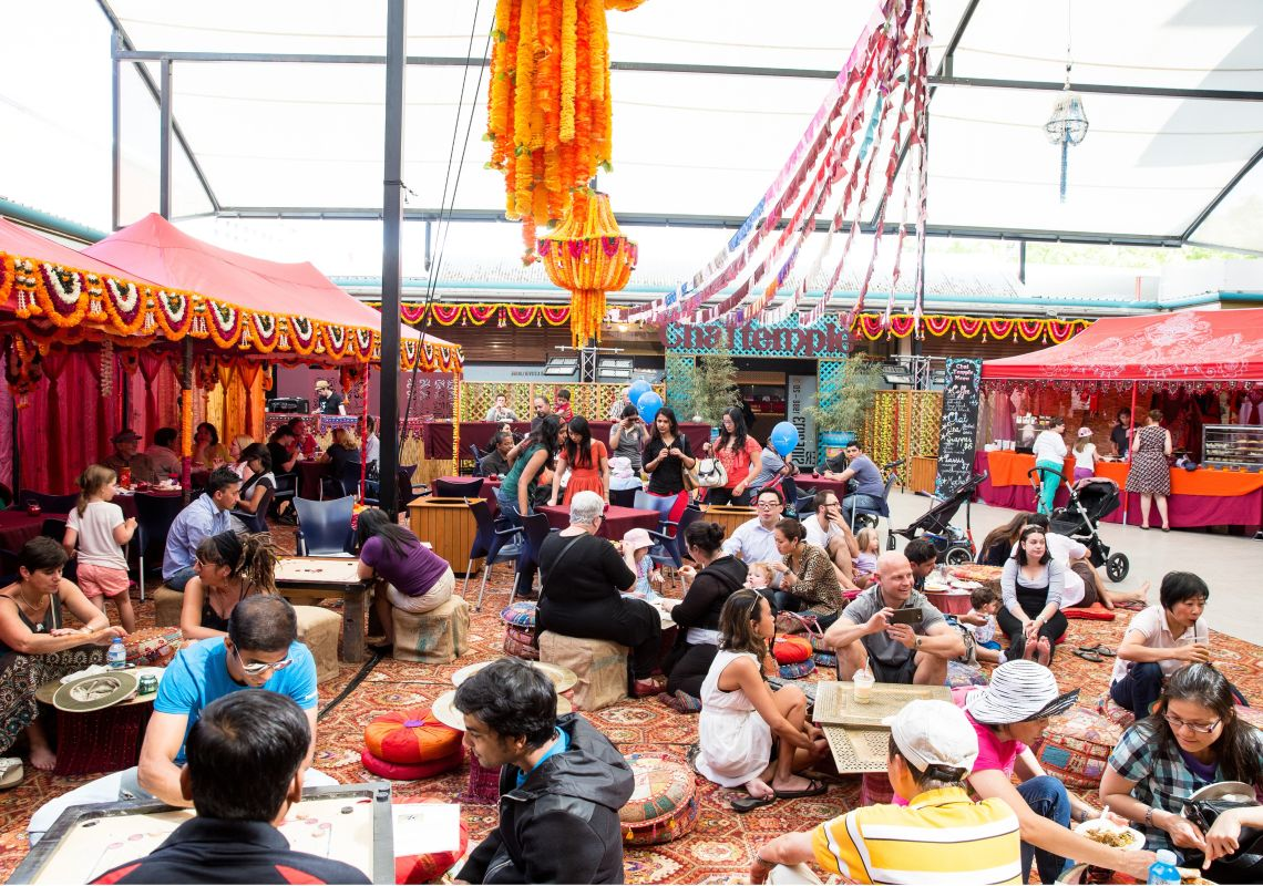 People relaxing at a pop-up chai cafe, Parramasala festival, Parramatta