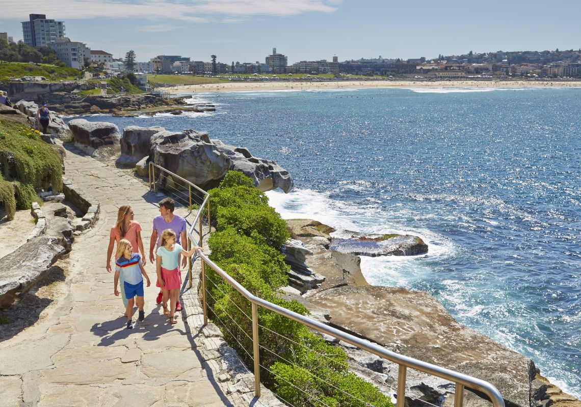 A family enjoy the Bondi to Bronte Walk in Sydney East