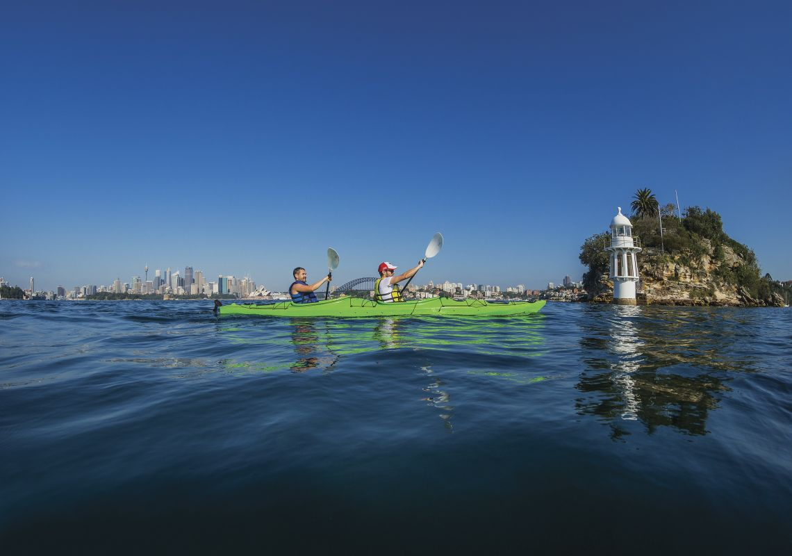 Men kayaking on Sydney Harbour near Cremorne Point