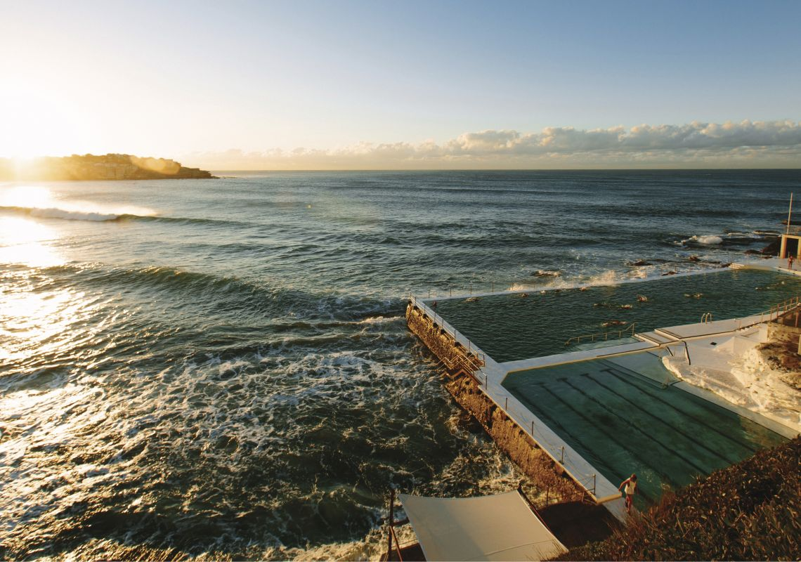 Sun rising over Bondi Icebergs at Bondi Beach, Sydney