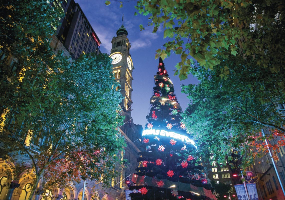 A Christmas tree sparkling at twilight in Martin Place, Sydney