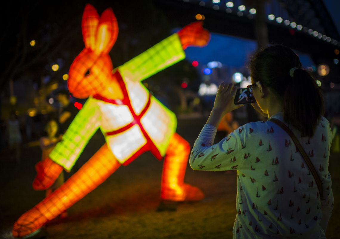 A woman photographs a Rabbit zodiac lantern, Sydney Lunar New Year