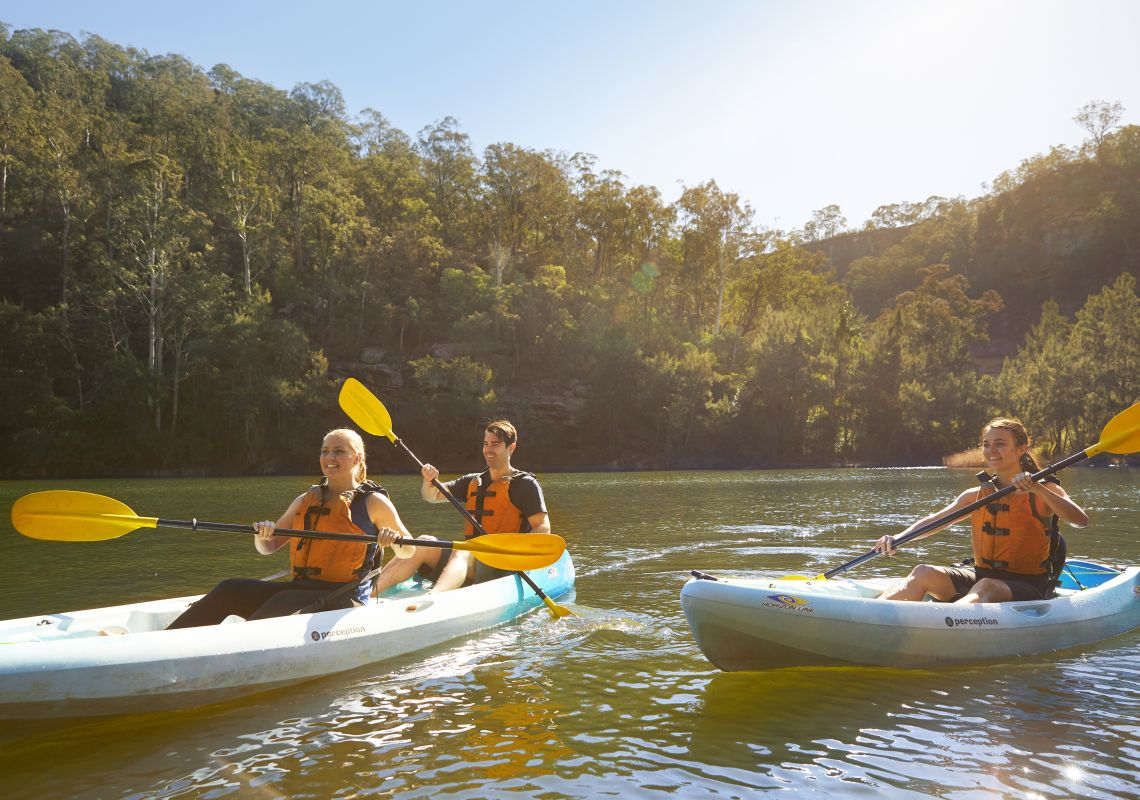 Friends kayaking along the Nepean River in Penrith, Sydney