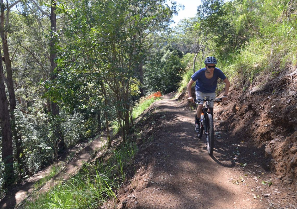 A cyclist riding on the Hornsby Mountain Bike Trail, in northern Sydney