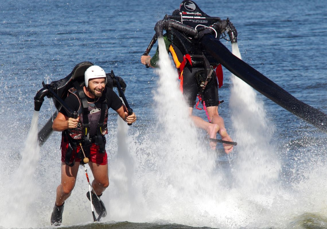 A jetpack-strapped man flying out of the water, Sydney International Regatta Centre