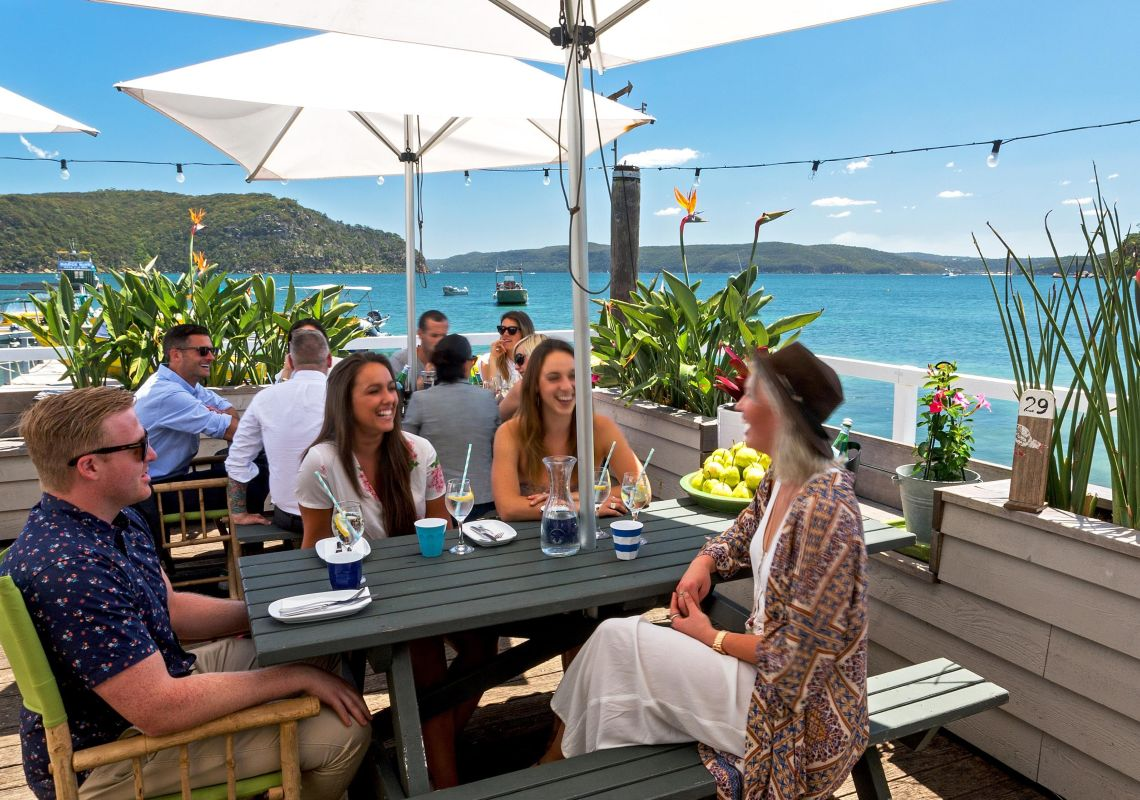 Friends enjoying lunch at The Boathouse Palm Beach, Sydney