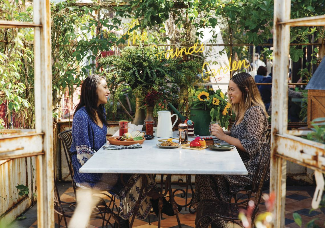 Friends enjoying breakfast and morning tea at the Grounds of Alexandria in Alexandria, Sydney