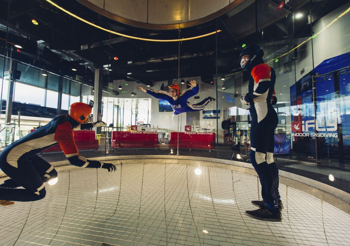 Woman enjoying an indoor skydiving experience at iFly Downunder, Penrith in Sydney's western suburbs.