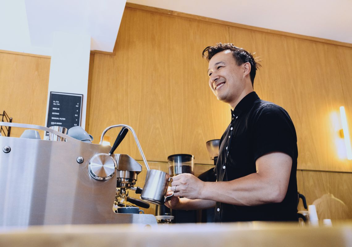 Barista making morning coffees at Artificer Cafe, Surry Hills