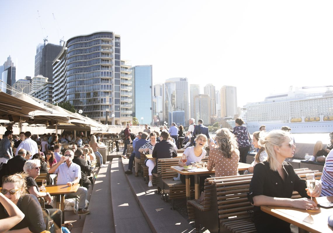 People enjoying food and drinks with a view at Opera Bar, Sydney Harbour