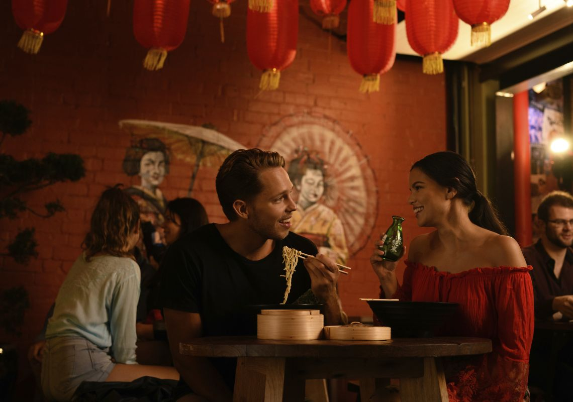 Couple enjoying food and drink in Spice Alley, Chippendale
