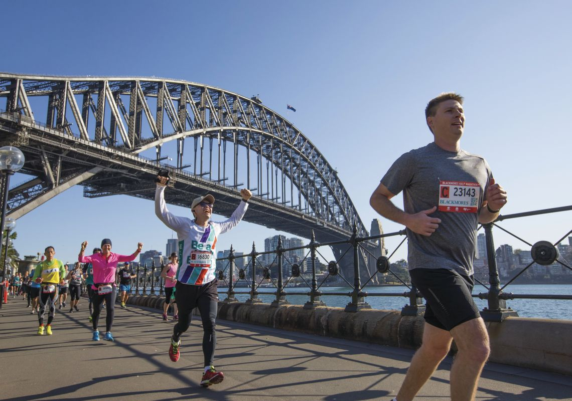 Participants in the 2017 Blackmores Sydney Running Festival passing through Dawes Point with views of the Sydney Harbour Bridge, Sydney Harbour