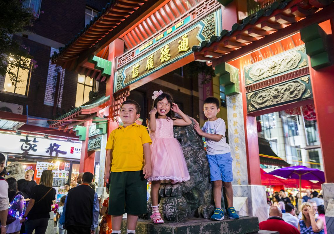 Children enjoying a night out at Chinatown Night Markets on Dixon street in Chinatown, Sydney City