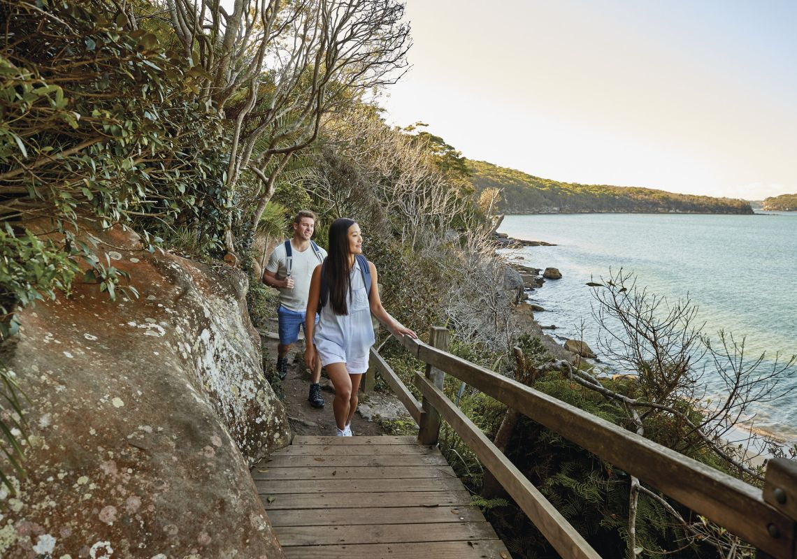 Couple enjoying the walk from Spit Bridge to Manly with scenic views across Sydney Harbour