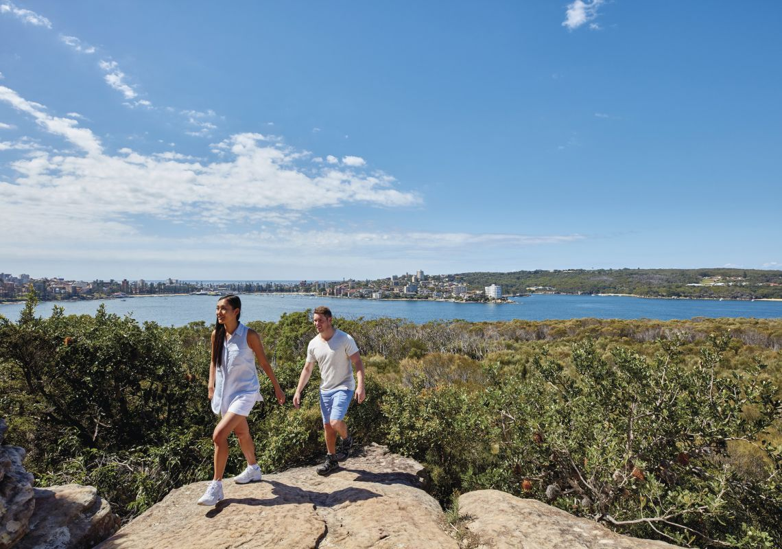 Couple enjoying stunning coastal views of Sydney Harbour from Dobroyd Head, Balgowlah Heights