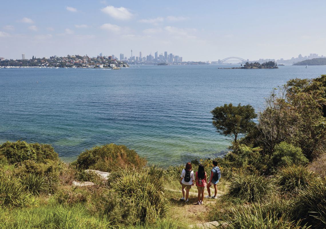 Friends enjoying scenic harbour views along the Hermitage Foreshore Track in Vaucluse, Sydney East