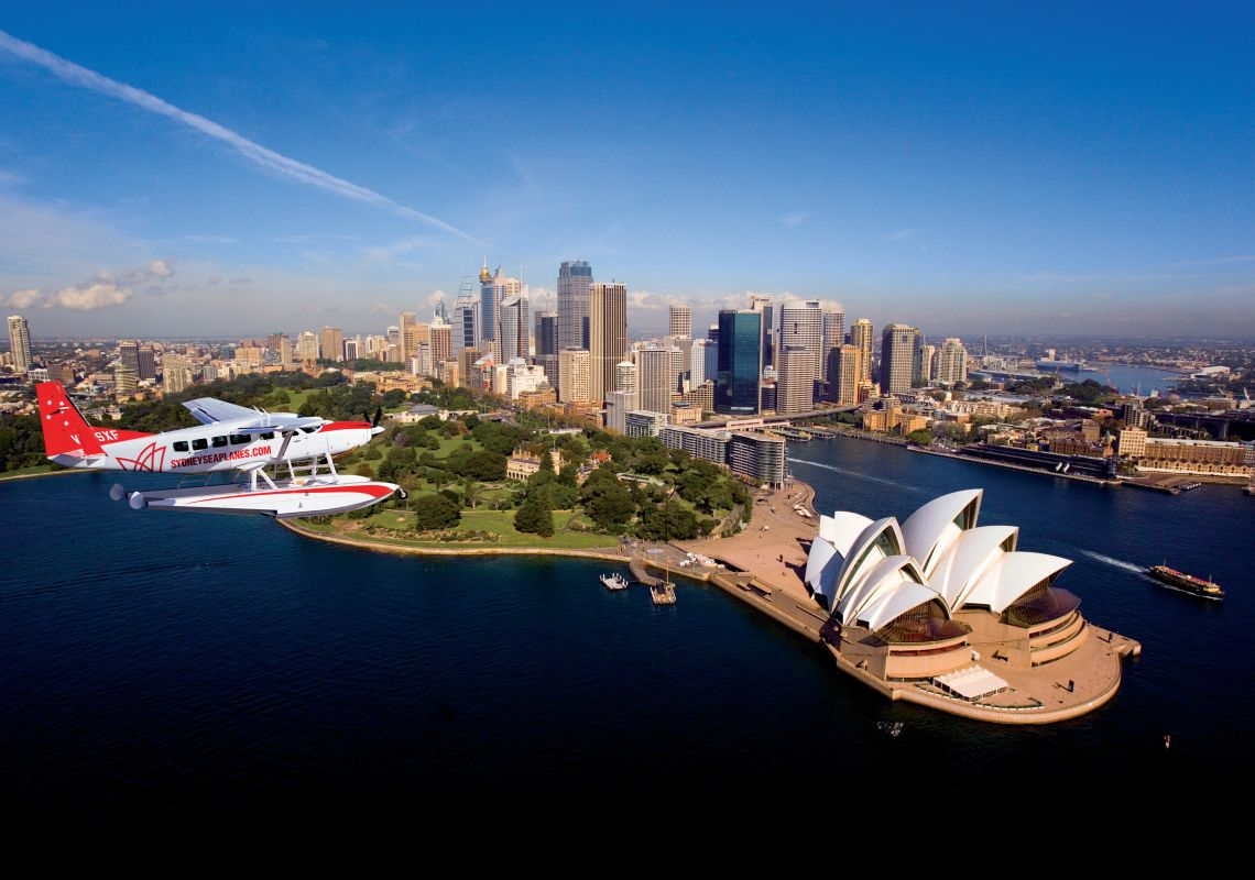 A Sydney Seaplane flying over Sydney harbour