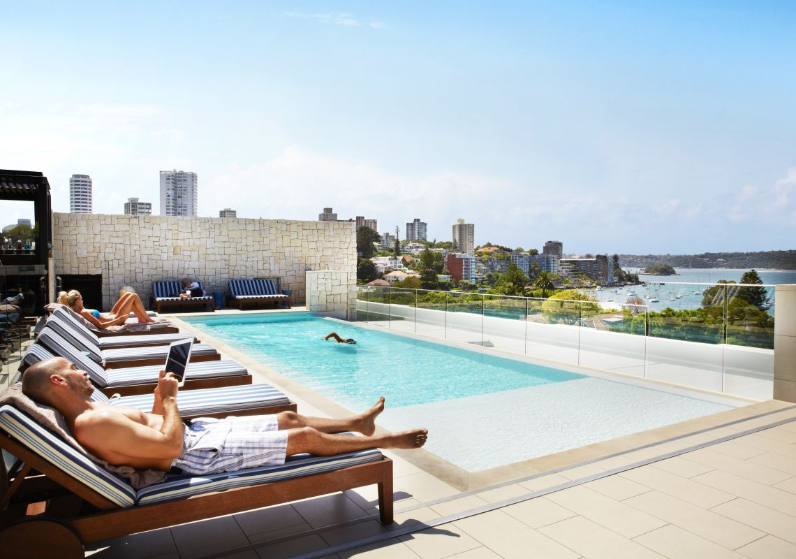 Guests relaxing by the rooftop pool at the Intercontinental Hotel in Double Bay, Sydney East