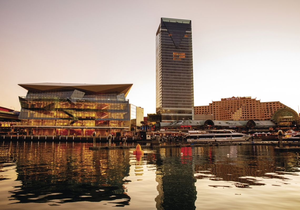 Sun setting over the International Convention Centre (ICC) and Sofitel Darling Harbour, Sydney