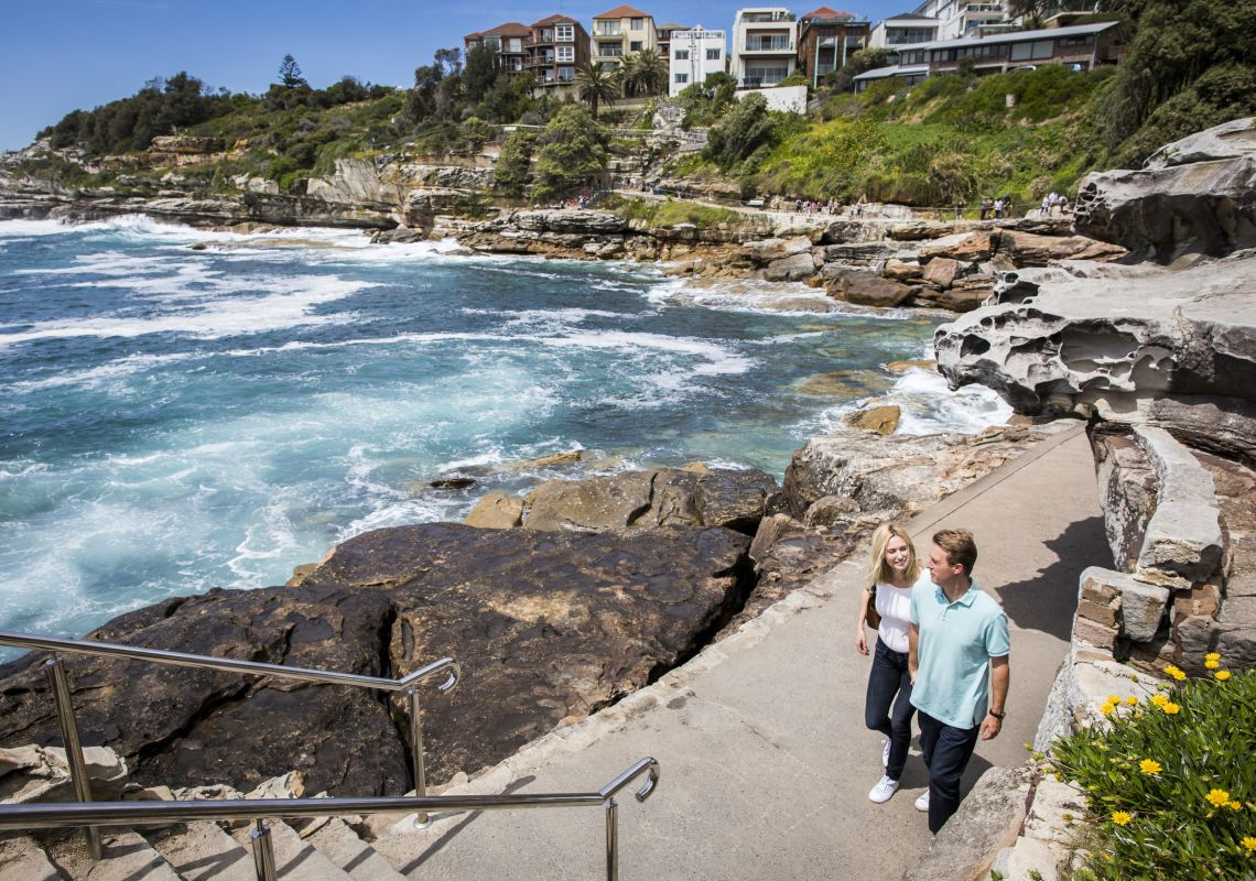 Couple enjoying the scenic Bondi to Bronte coastal walk in Bondi , Sydney East
