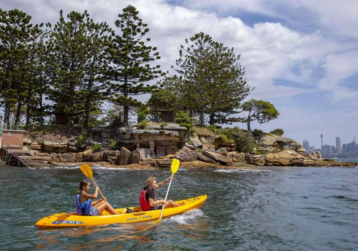 Couple enjoying a day of kayaking on Sydney Harbour, Sydney City
