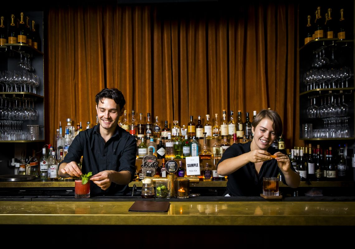 Bartenders creating cocktails at the Golden Age Cinema & Bar in Surry Hills