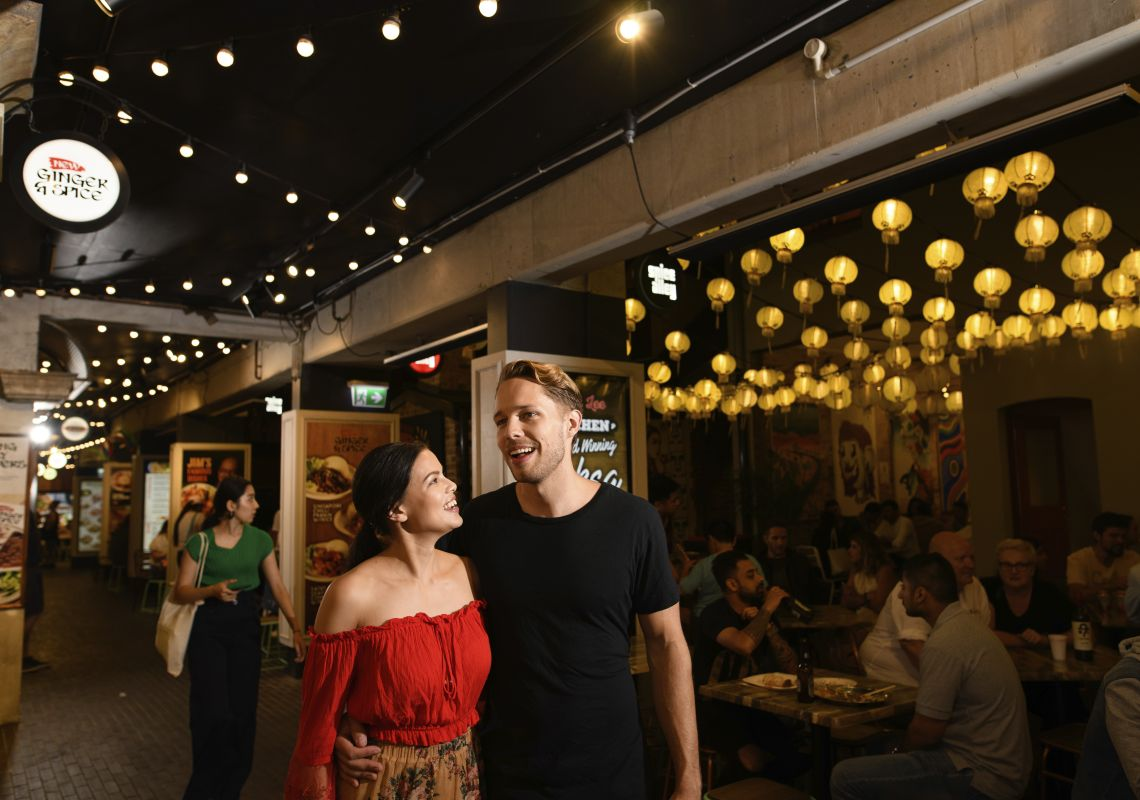 Couple enjoying food and drink in Spice Alley in Chippendale