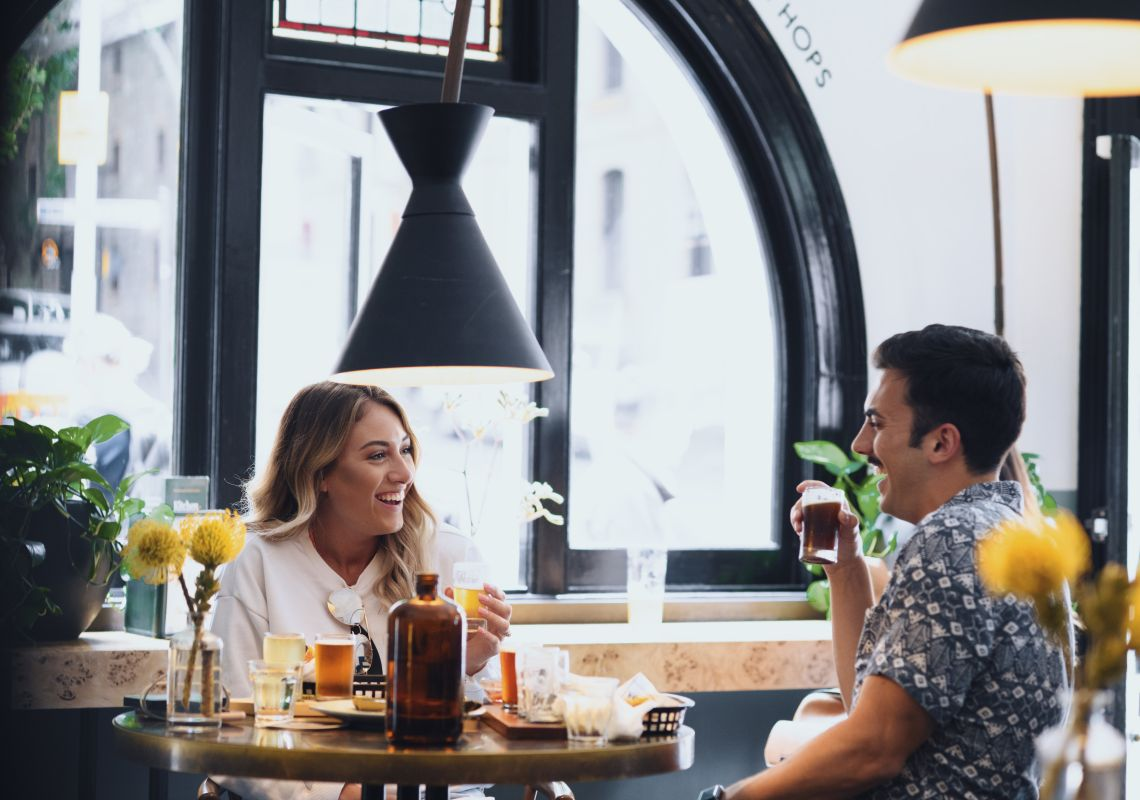 Couple enjoying food and drinks at the Endeavour Tap Rooms in The Rocks, Sydney City