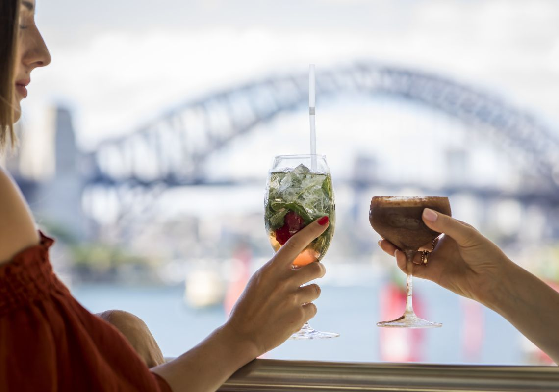Friends enjoying drinks with a view at Hacienda Bar, Pullman Quay Grand Sydney Harbour, Sydney City