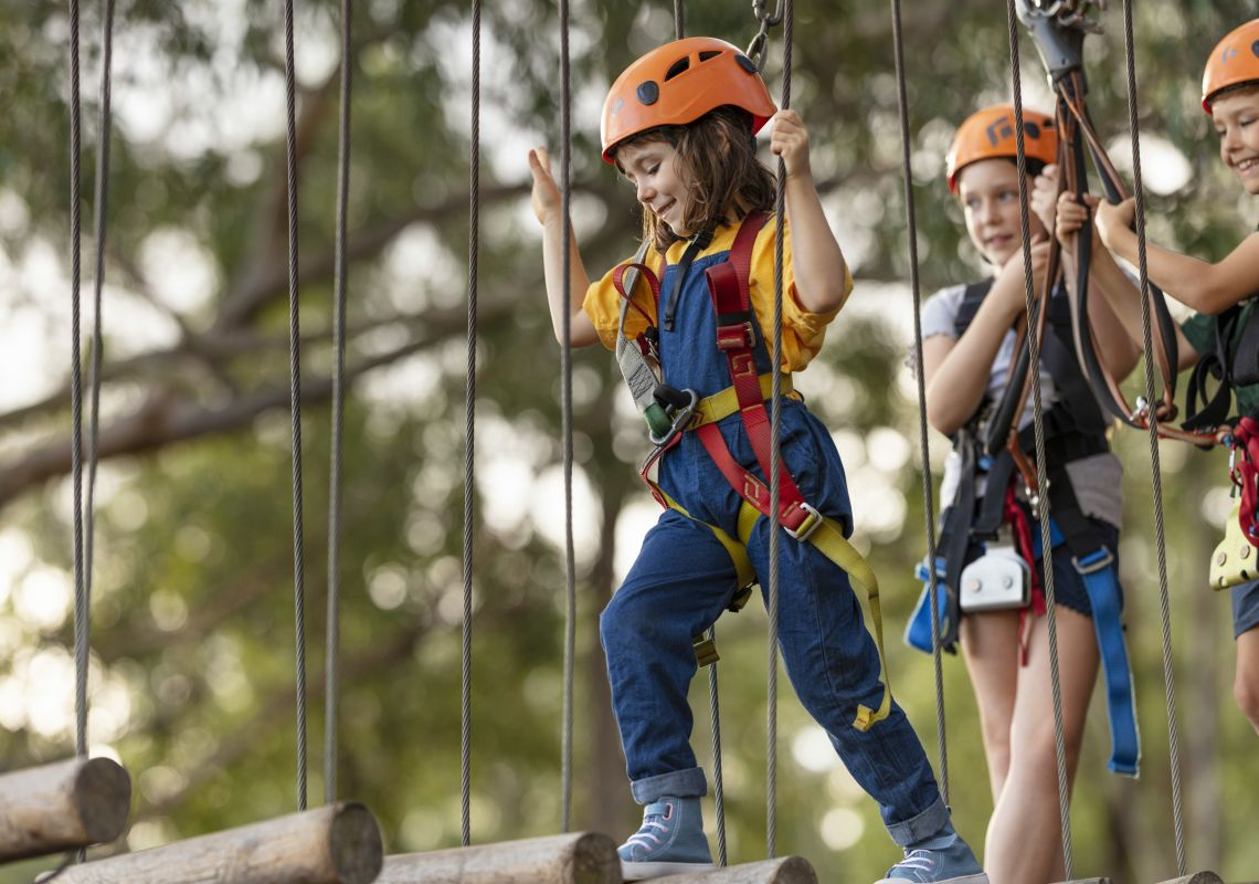 Young girl enjoying the action at TreeTops Adventure Park in Abbotsbury, Sydney West