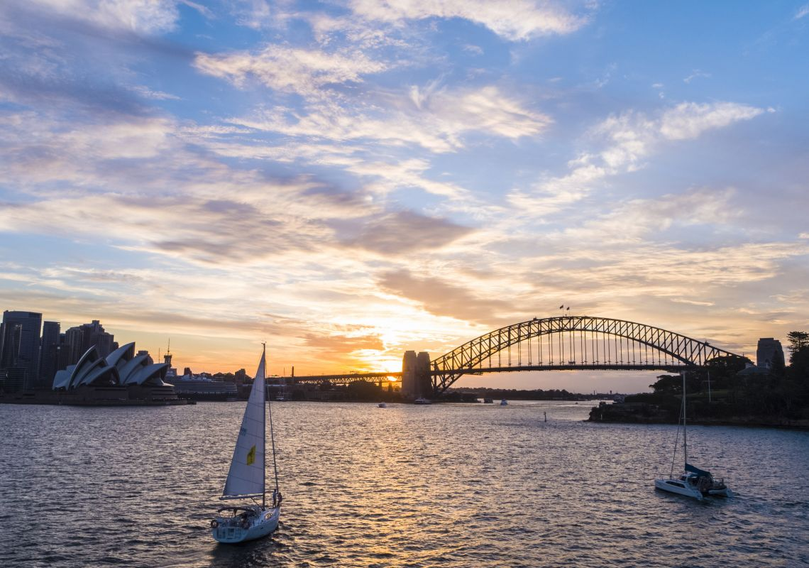 Sun setting over a sail boat on Sydney Harbour, Sydney City