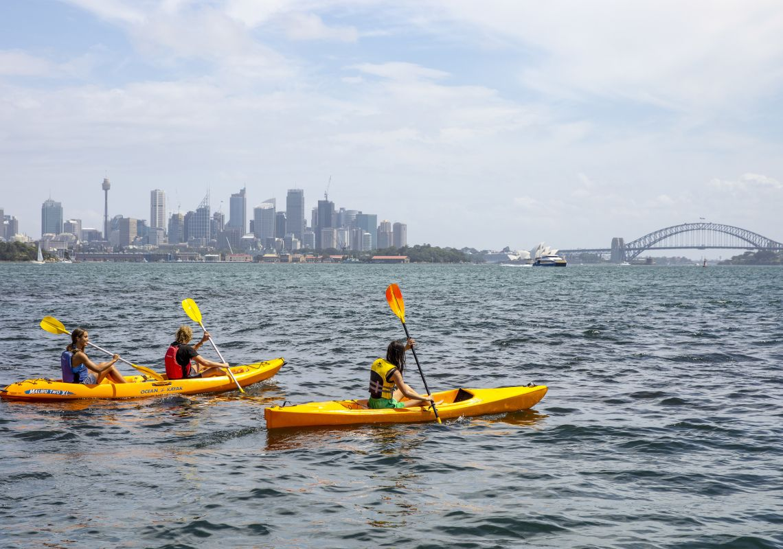 Friends enjoying a day of kayaking on Sydney Harbour, Sydney city