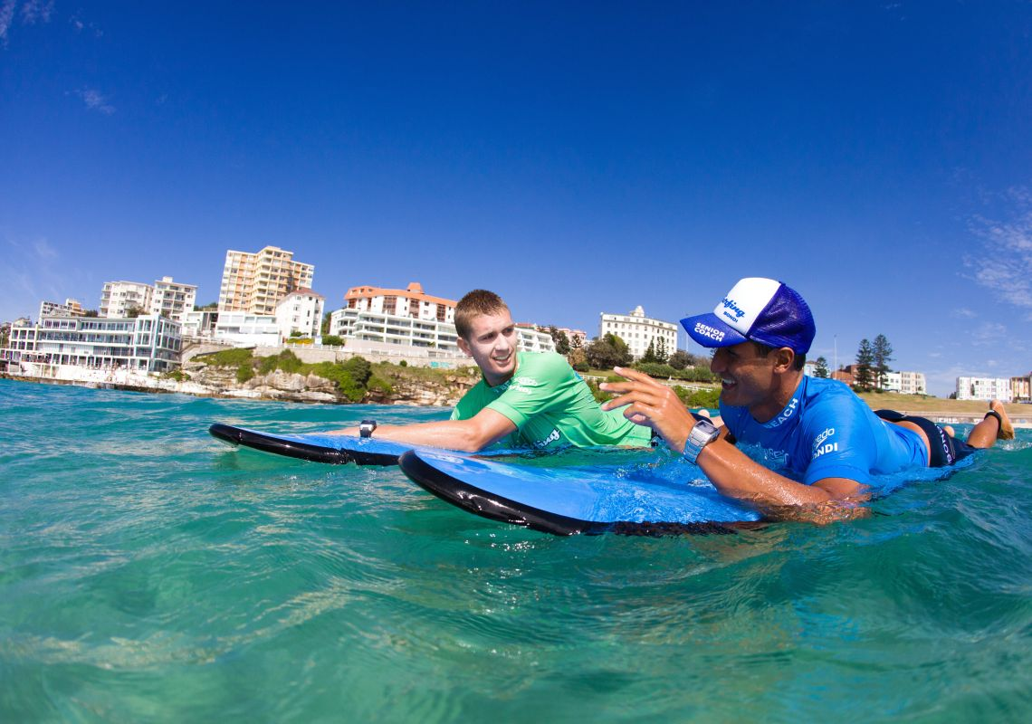 Learning to surf with 'Let's Go Surfing' at Bondi Beach