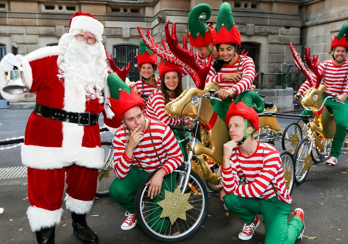 Santa and some elves in the city, Sydney