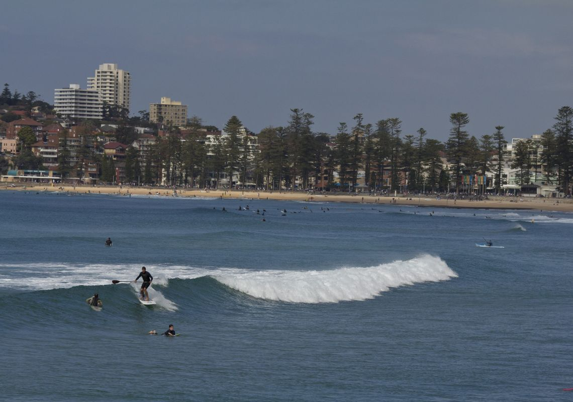 Surfing at Queenscliff Beach in Manly, Sydney North