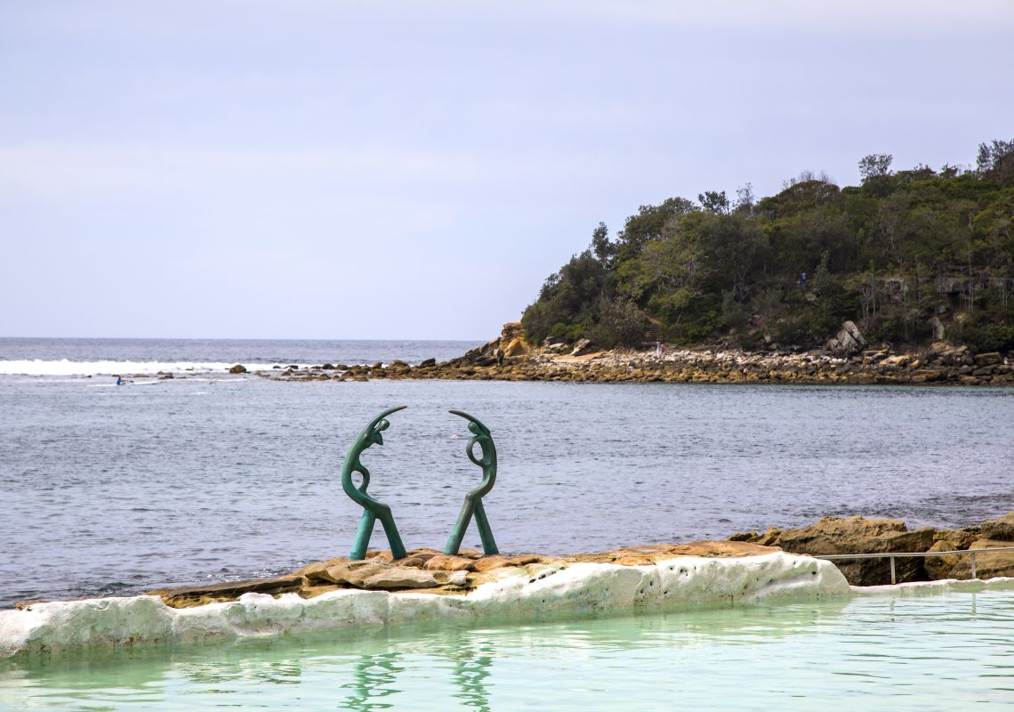 Helen Leete's Oceanides sculpture adorning the edge of Fairy Bower ocean pool in Manly
