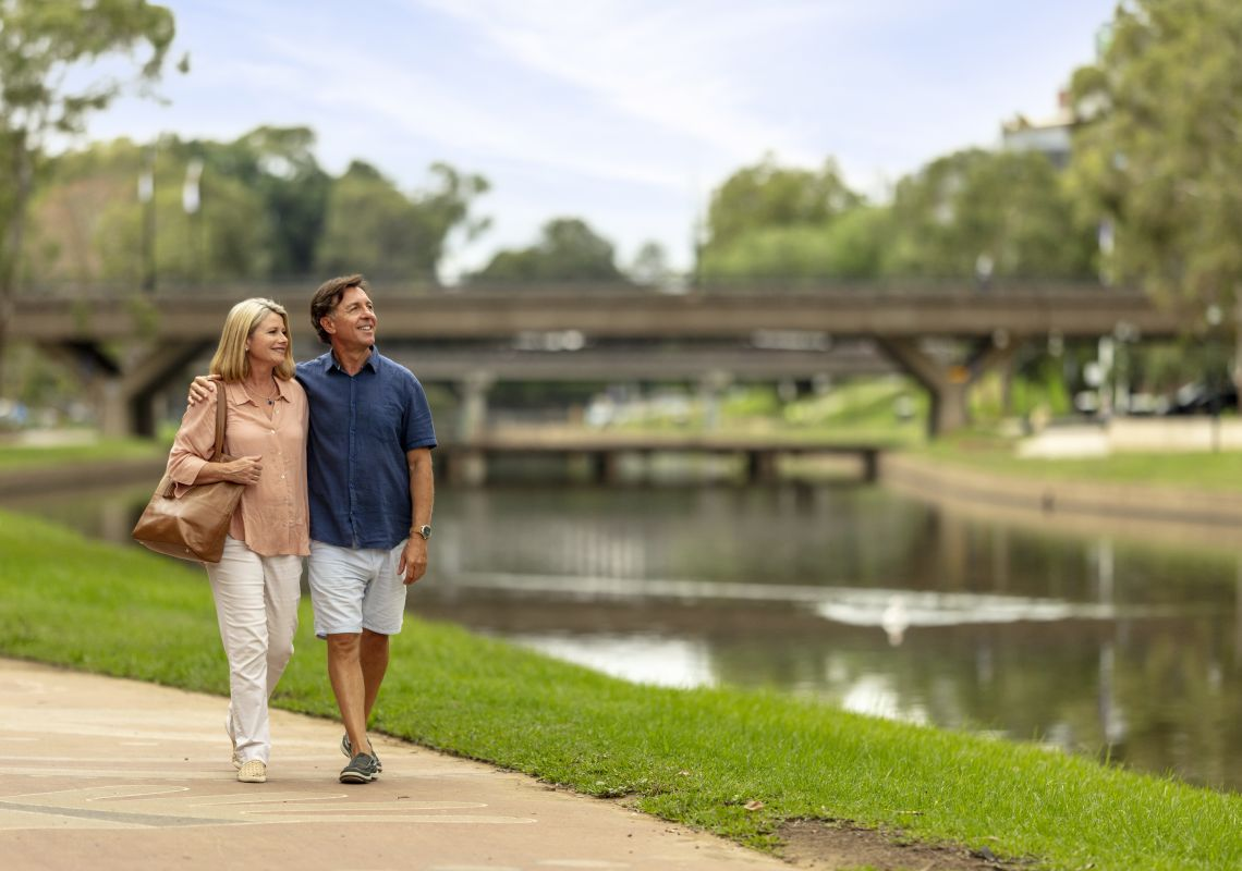 Couple enjoying a walk alongside Parramatta River in Parramatta, Sydney West