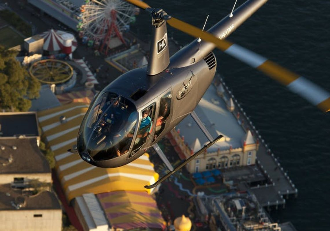 Blue Sky Helicopters R44 over Luna Park in Mascot, Sydney South