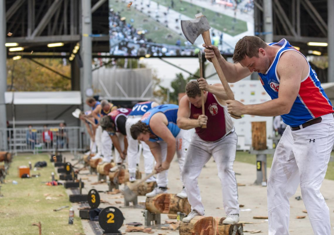 Men competing in the woodchopping competition at the 2019 Sydney Royal Easter Show, Sydney Showground at Sydney Olympic Park
