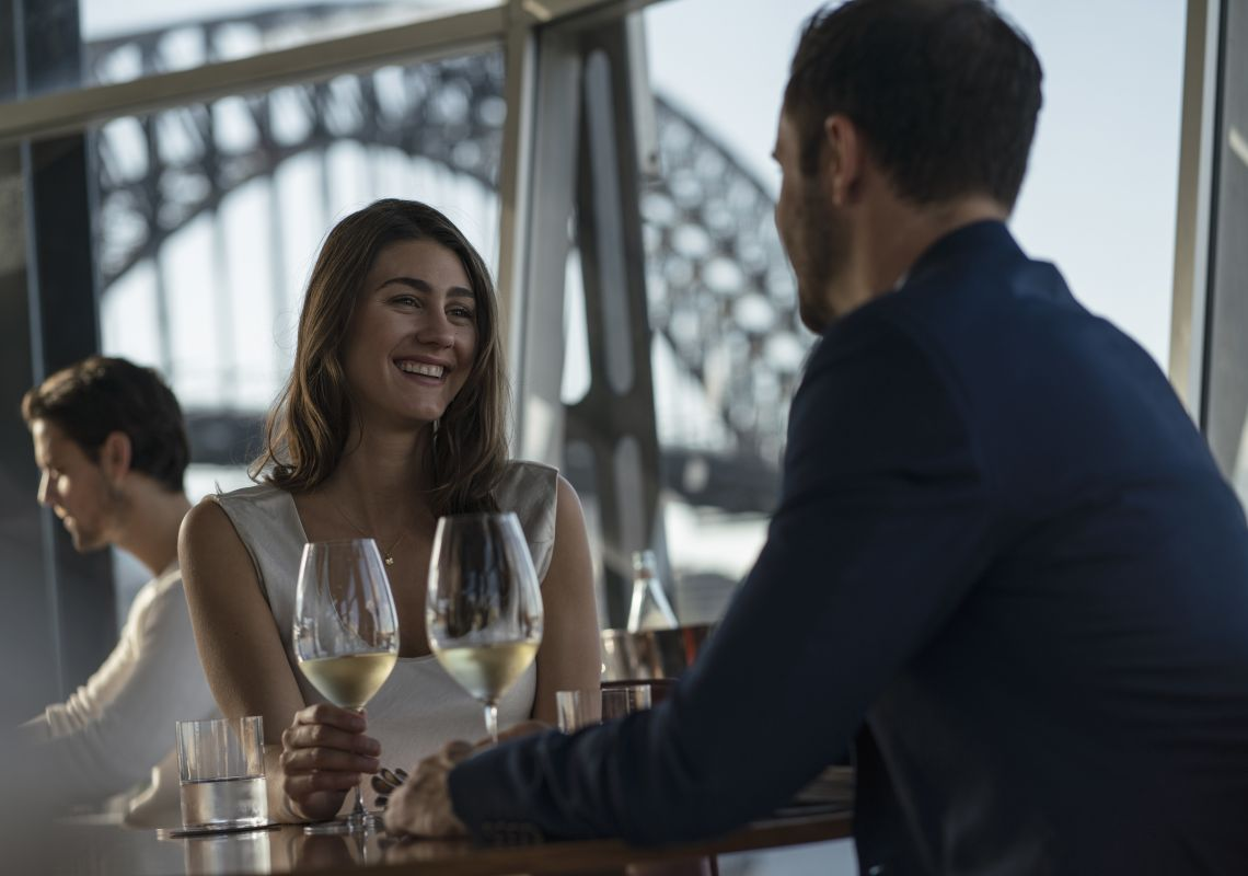 Couple enjoying food and drink at Quay Restaurant, The Rocks