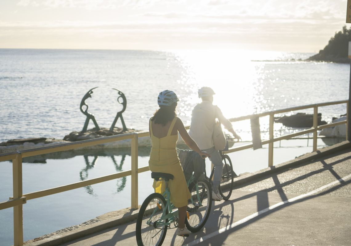 Couple enjoying a self-guided tour of Manly with Manly Bike Tours.